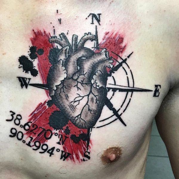Heart on chest trash polka tattoo