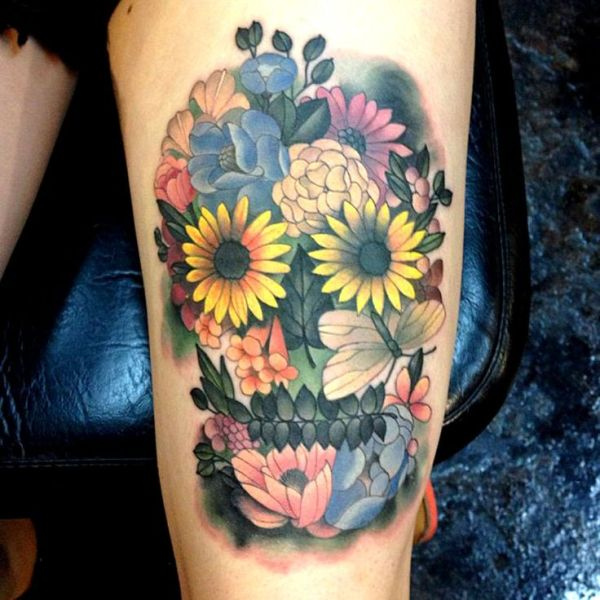 colorful flowers skull tattoo on thigh