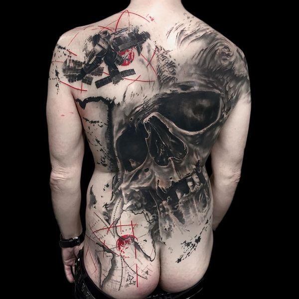 realistic back trash polka tattoo
