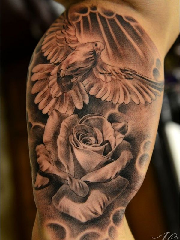 dove with rose flower tattoo on arm
