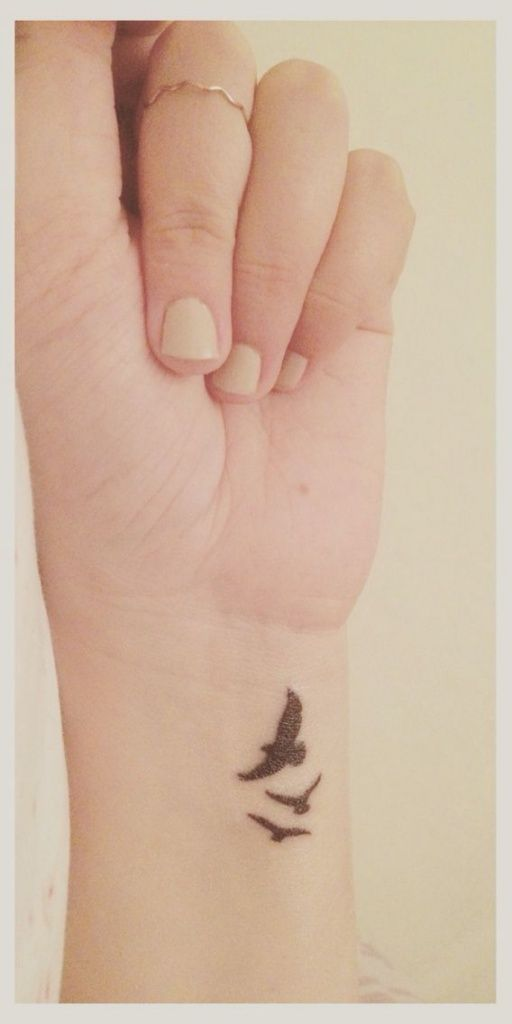 seagulls tattoo on wrist for women