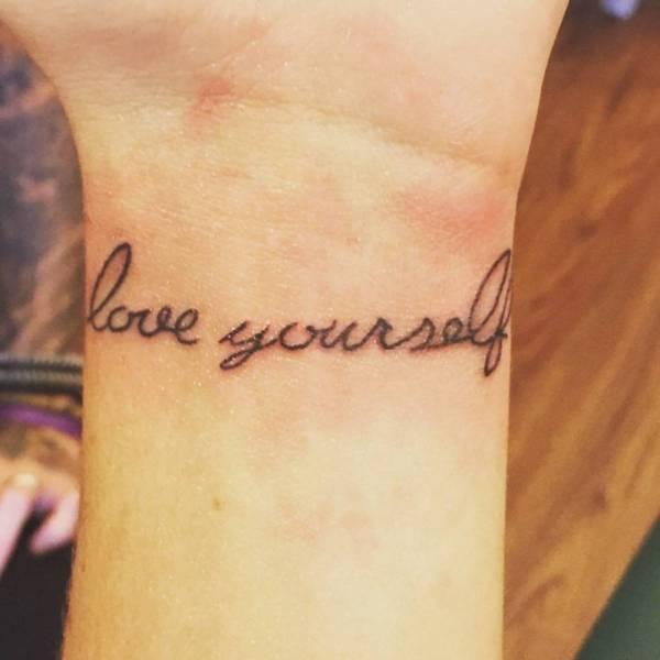 love yourself tattoo on wrist