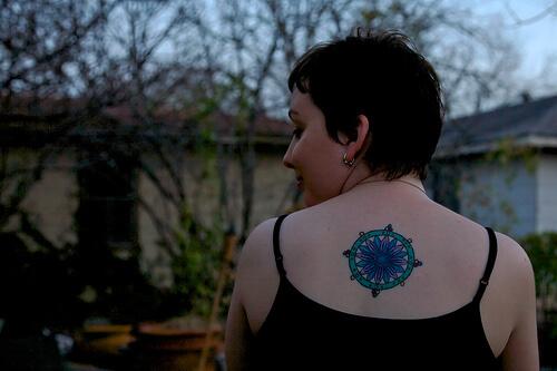 dharma wheel tattoo on back