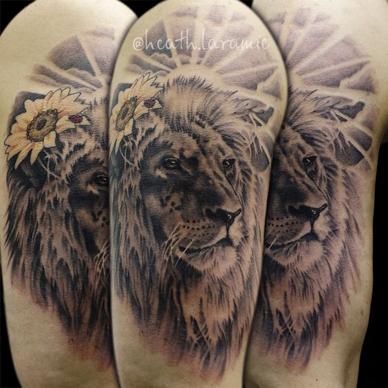 lion with sunflower upper sleeve men tattoo