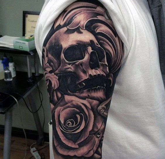 skull and rose tattoo on upper sleeve for men