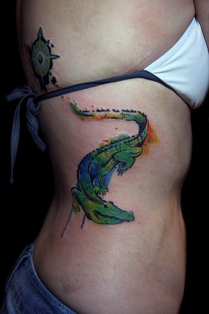 watercolor alligator tattoo design on side ribs
