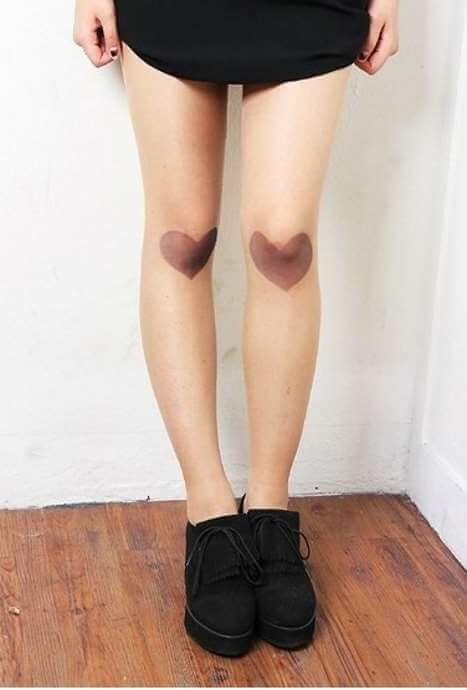 thumb print heart tattoos on knee cap