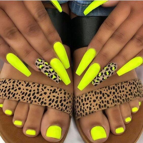 yellow neon nails with matching outfit panther printed pattern