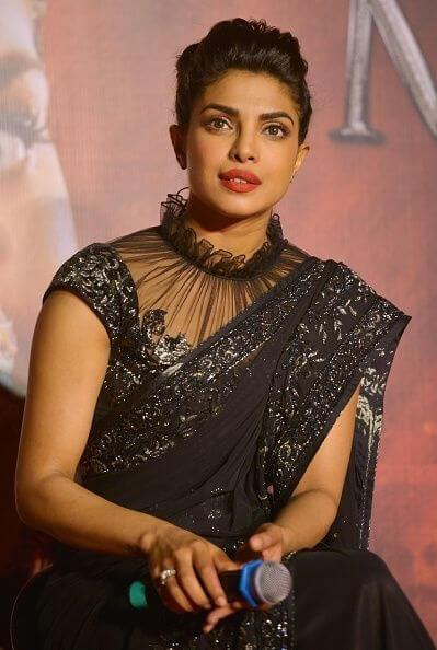 frilled choker collar blouse design with saree