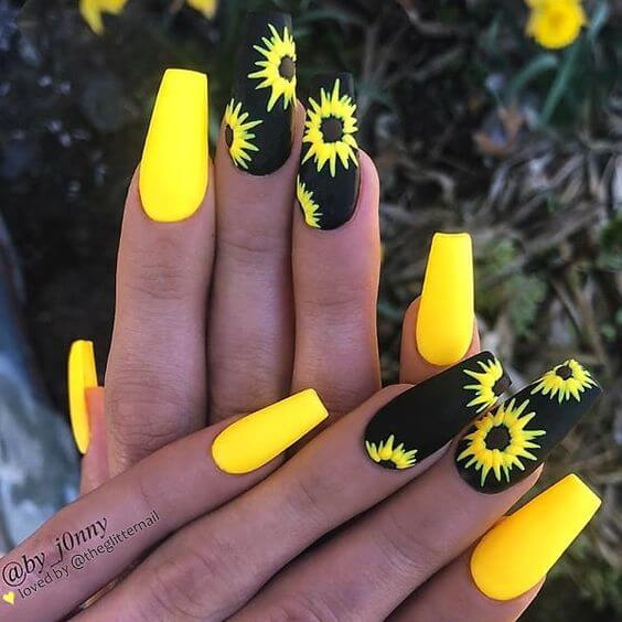 yellow and black nails with flowers