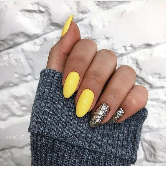 yellow nails with silver glitter designs