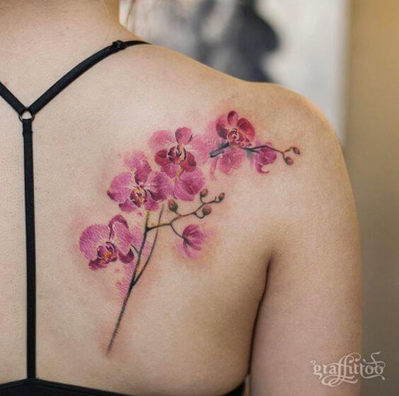 shoulder blade pink orchid flowers tattoo design