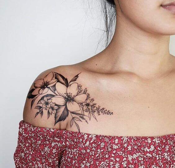 black and white jasmine tattoo design on shoulder