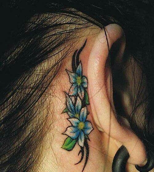 blue jasmine flower tattoo design behind ear