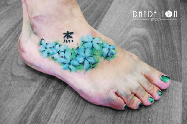 blue jasmine flower tattoo design on foot