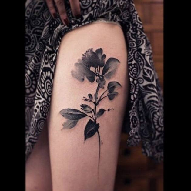 watercolor black jasmine flower tattoo design on thigh