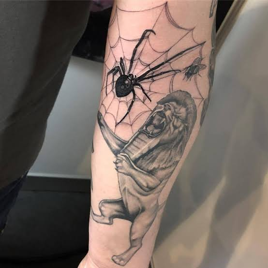 back arm spider web tattoo