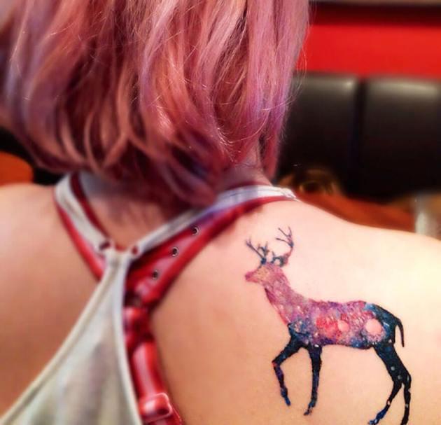 cosmic deer astronomy tattoo design on back shoulder blade