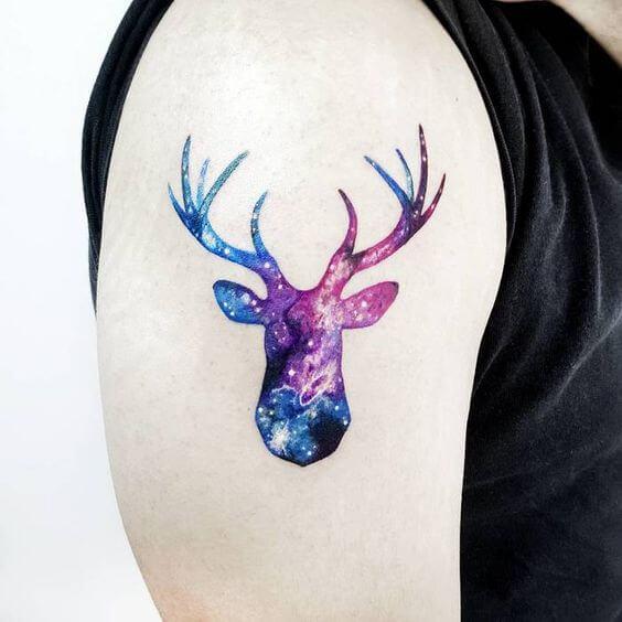 cosmic deer astronomy tattoo design on upper arm