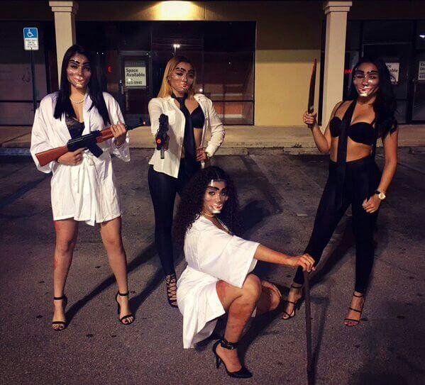 hot girls in black and white outfits with weapons group of 4 purge halloween costume ideas