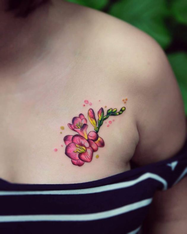 pink freesia flowers tattoo design on chest