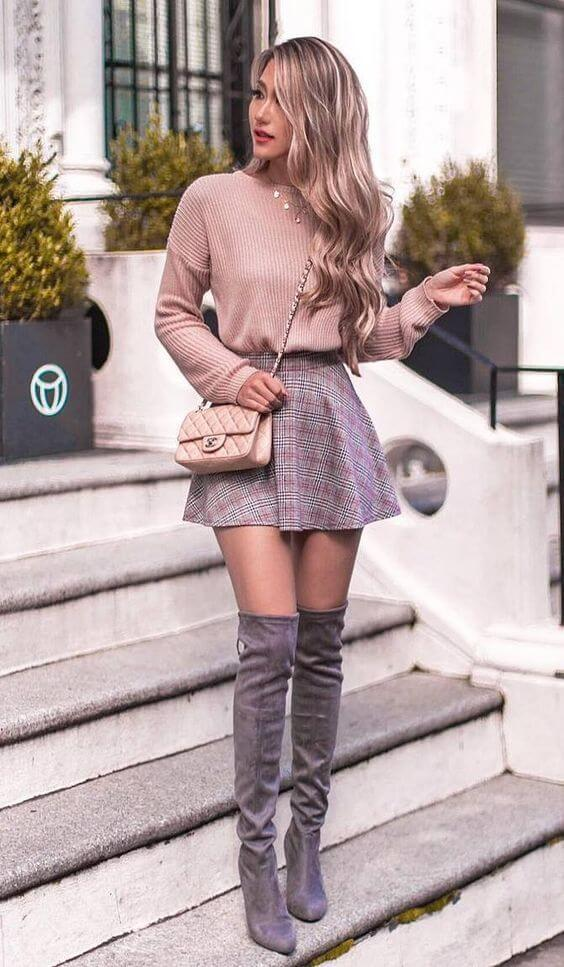 Beige sweater and plaid skirt with grey suede knee length boots winter outfit