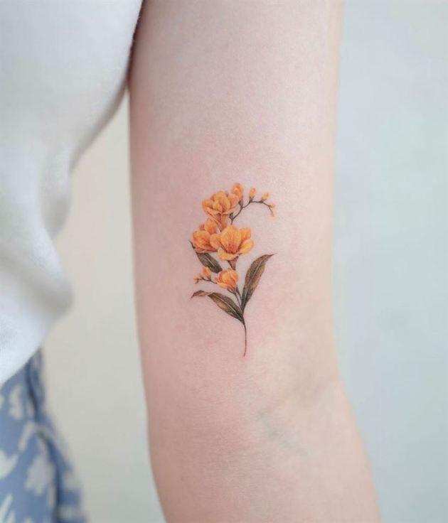 yellow freesia flowers tattoo design