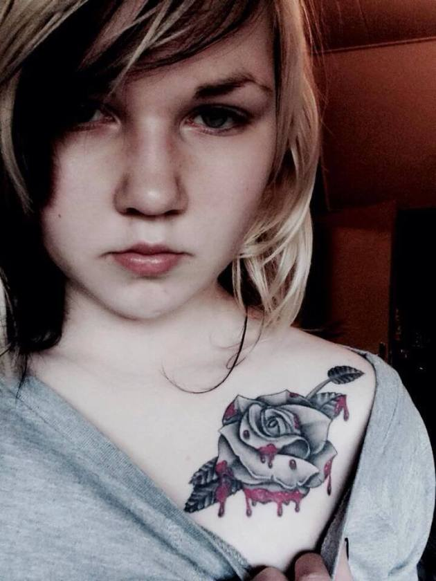 grey rose with red blood dripping tattoo design on shoulder