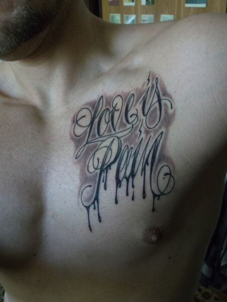 love is pain tattoo design on chest for men