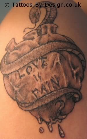 snake with human heart and love is a pain quote tattoo design