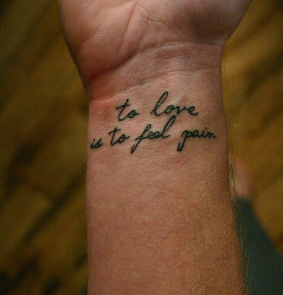 to love is to feel pain quote tattoo idea on wrist