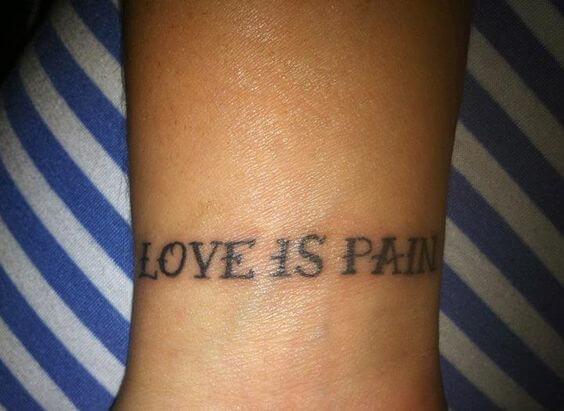 simple love is pain tattoo idea