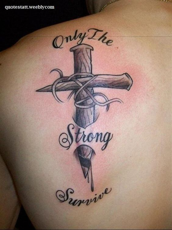 nailed cross in skin with only the strong survive tattoo design on shoulder blade