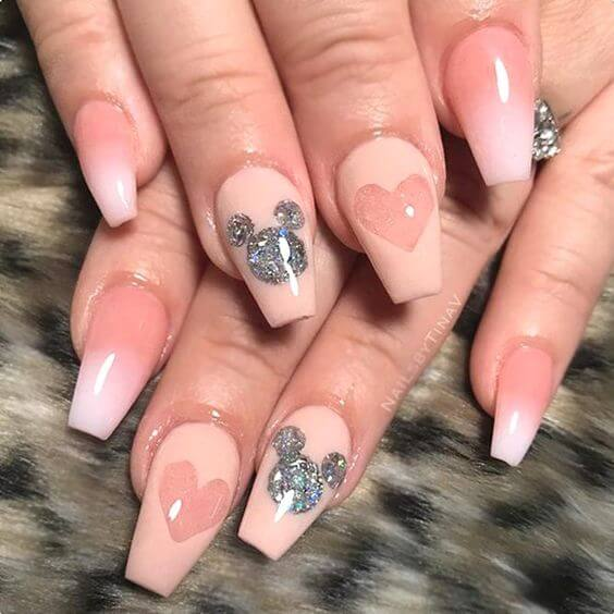 nude pink heart with silver mickey mouse nails design