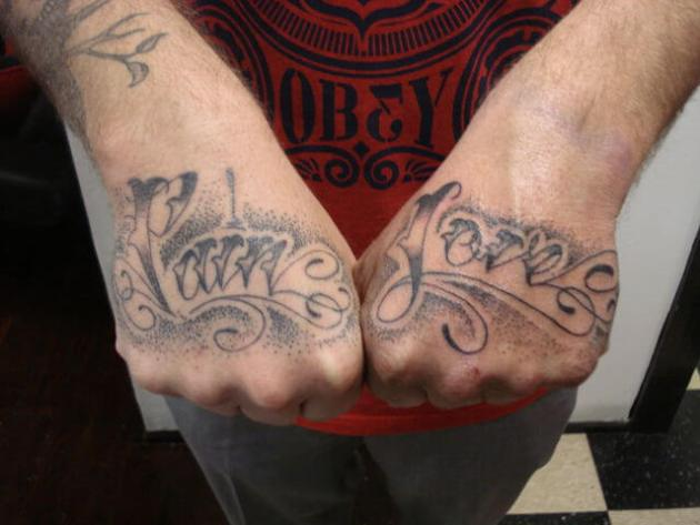 dotwork pain and love tattoos on hand