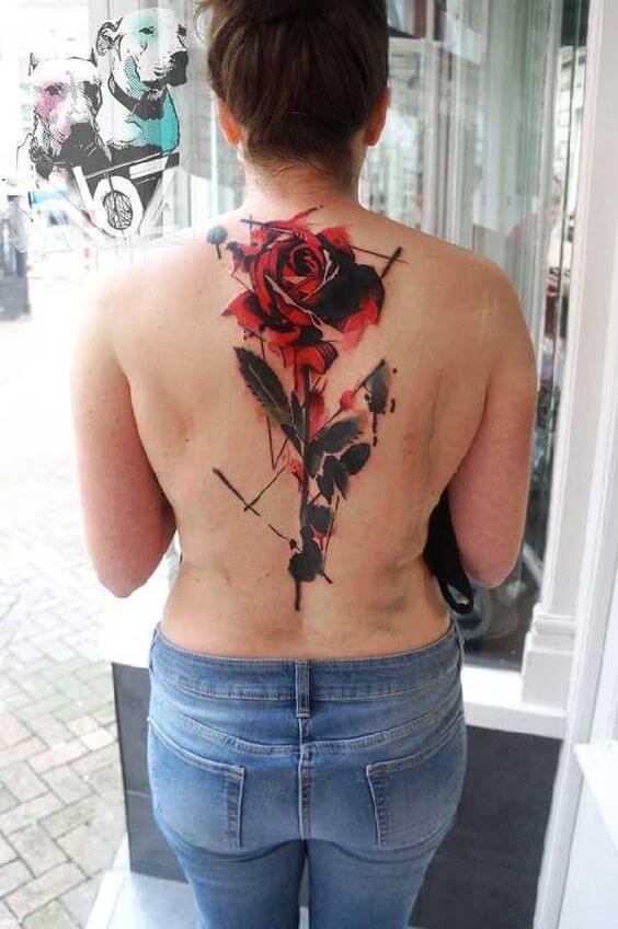 full back bleeding rose tattoo design for women