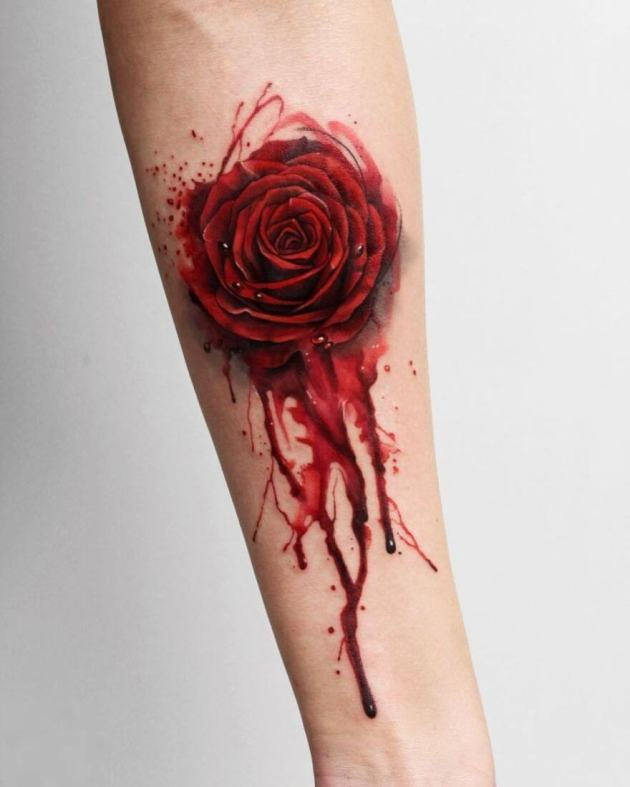watercolor red rose bleeding blood tattoo design on forearm