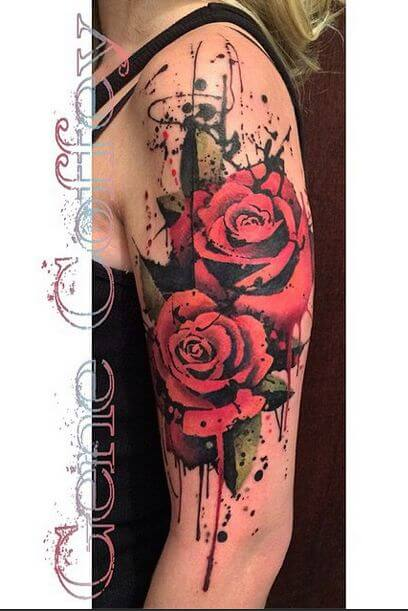 watercolor bunch of bleeding roses upper arm tattoo design