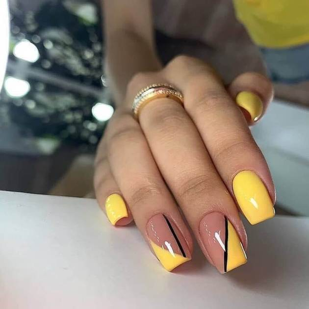 yellow and nude with single black line summer nails