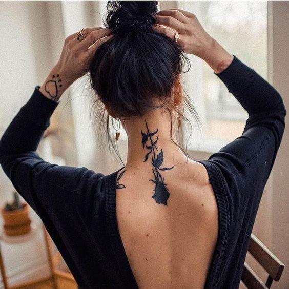 upside down black ink rose flower with bud tattoo design idea on back neck for females