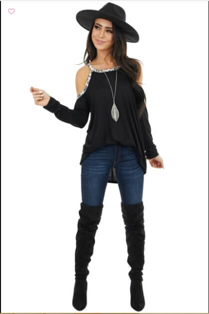 black cold shoulder top with matching hat and boots cowgirl outfit idea