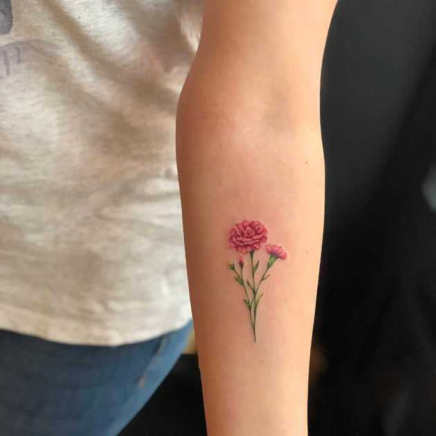 pink carnation January birth flowers with buds tattoos on forearm