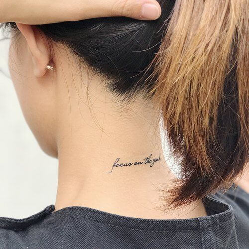 cute quote focus on the goal tattoo idea on back neck