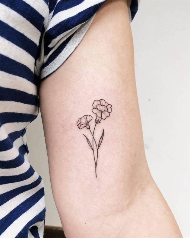 black and white carnation January birth flower tattoos on arm