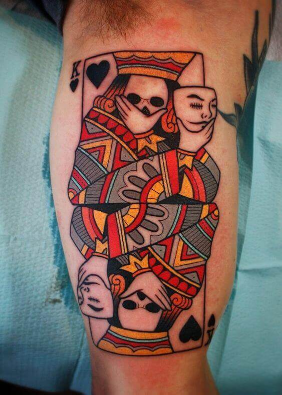 creepy masked traditional playing king card tattoo design for men