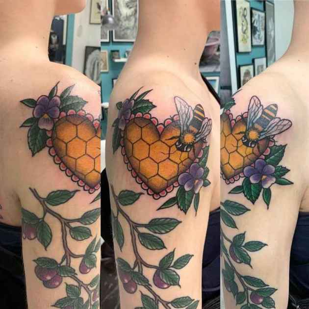 honey cells with bees and violets branch tattoo design on upper arm