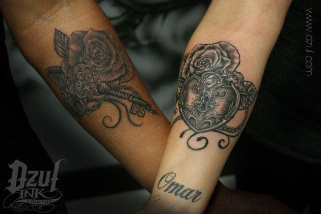 heart lock and key tattoos on black couple forearm