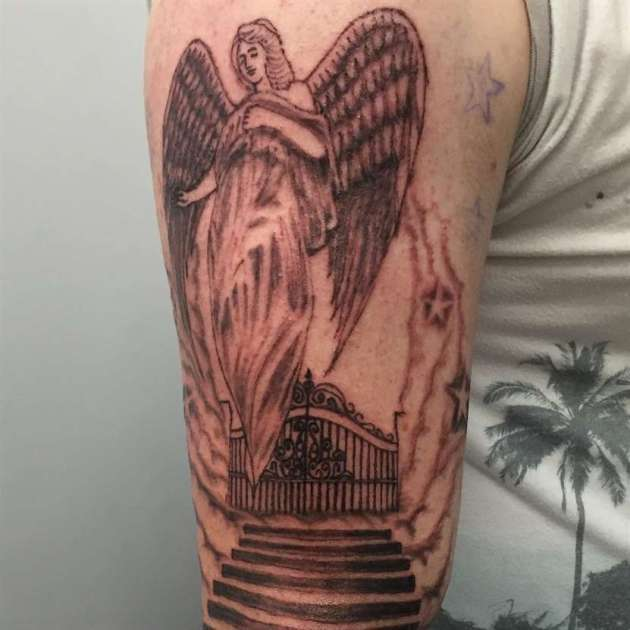 black and gray angel with gates of heaven tattoo design on half sleeve