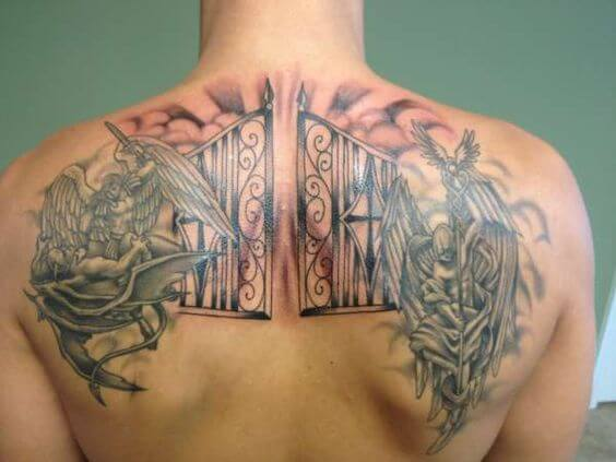 gates of heaven with angel and devil fight tattoo design on back