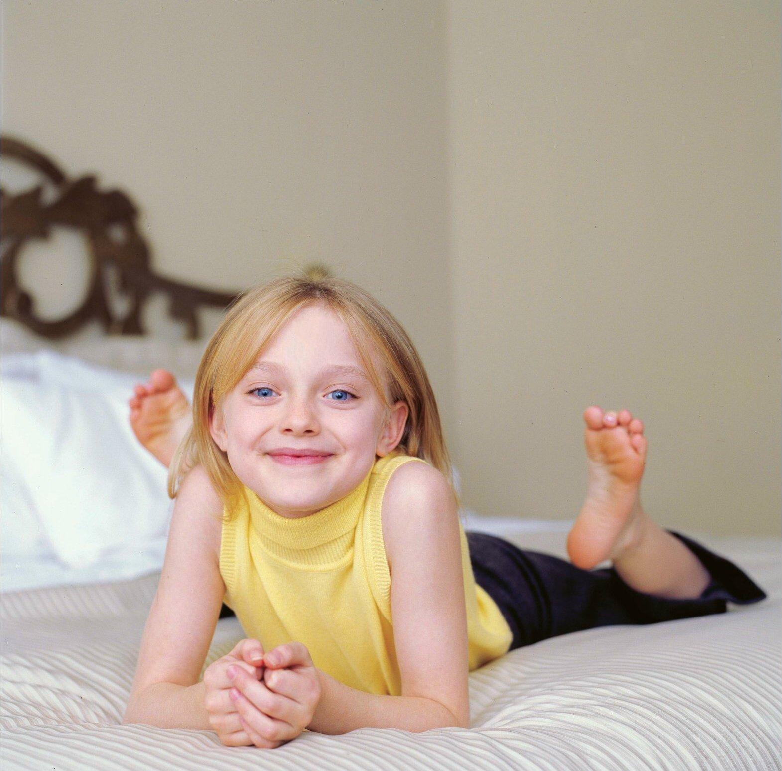 Dakota Fanning, foto de infância um em pinterest.com